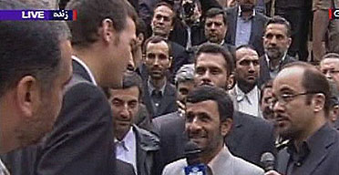 A video grab showing president Mahmoud Ahmadinejad speaking to one of the detained British sailors before he is released to officials at the UK embassy in Tehran.
