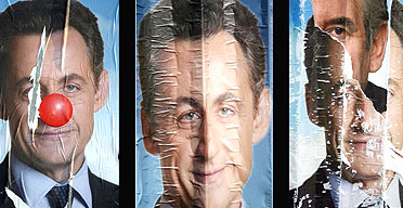 Defaced campaign posters featuring the French rightwing presidential candidate Nicolas Sarkozy