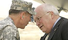 The US vice-president, Dick Cheney, is greeted by the commander of US forces in Iraq, General David Petraeus, on his arrival at Baghdad international airport