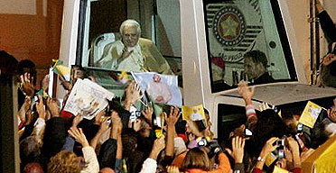 Thousands of people wave as Pope Benedict XVI arrives at the Sao Bento monastery in Sao Paulo, Brazil.