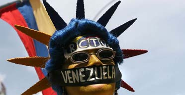 An RCTV supporter marches in Caracas to protest the Venezuelan government's decision not to renew the television station's licence