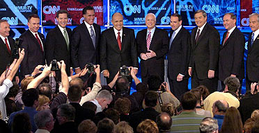 Republican presidential hopefuls: (l-r) Representative Tom Tancredo (Colorado), former governor Tommy Thompson (Wisconsin), Senator Sam Brownback (Kansas), former governor Mitt Romney (Massachusetts), former New York mayor Rudy Giuliani, Senator John McCain (Arizona), former governor Mike Huckabee (Arkansas), Representative Duncan Hunter (California), former governor Jim Gillmore (Virginia) and Representative Ron Paul (Texas) at the start of the Republican debate.