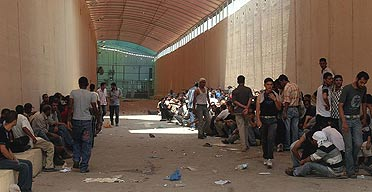 Palestinians wait to cross to the Israeli side at the Erez Crossing, in the northern Gaza Strip.