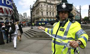 A police officer cordons off Piccadilly Circus after a car bomb was discovered