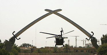 Two US Black Hawk helicopters take off from the Green Zone in Baghdad.