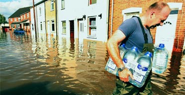 An aid worker delivers water in Gloucester