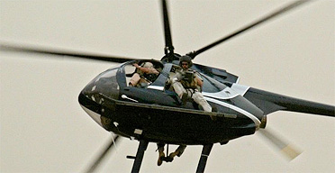 Private security men from Blackwater in a helicopter over Baghdad