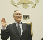Former US defence secretary Donald Rumsfeld is sworn in prior to testifying before the House oversight and government reform committee hearing investigating the death of Cpl Pat Tillman in Af