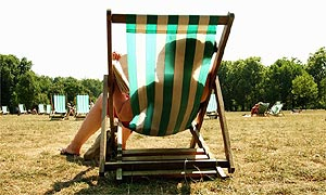A woman reading whilst sitting in a deckchair