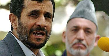 The Iranian president, Mahmoud Ahmadinejad, addresses a press conference in Kabul as his Afghan counterpart, Hamid Karzai, looks on