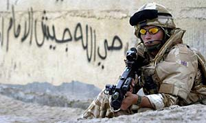 A British soldier on patrol in Basra, Iraq