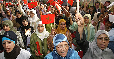 Women wave Moroccan flags as they cheer Saadeddine Othmani, the leader of the Islamist Justice and Development Party