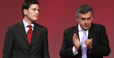 Gordon Brown applauds David Miliband