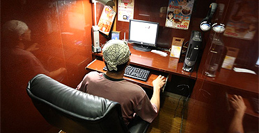 'Eddie' in the cubicle where he will spend the night in the MangaSquare 24-hour internet cafe in Tokyo