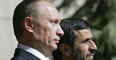 Vladimir Putin and Mahmoud Ahmadinejad