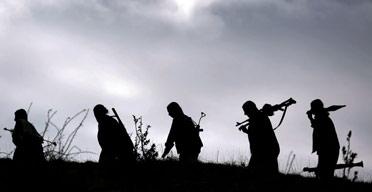 Kurdistan Workers' Party (PKK) rebels walking along a ridge during military exercises