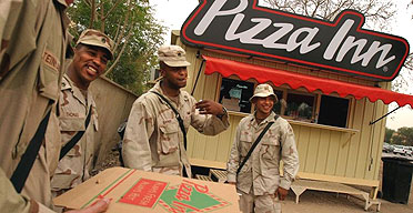 US soldiers pick up dinner from the Pizza Inn kiosk inside the green zone in Baghdad