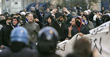 Football fans face police as they stage a protest in Milan