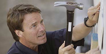 Democratic presidential candidate John Edwards works on a house at the Habitat for Humanity Musician's Village in New Orleans