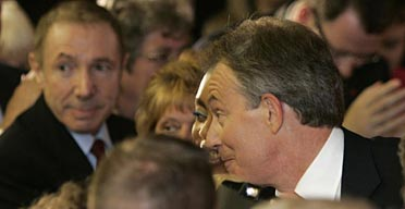 Labour donor David Abrahams is seen standing in the crowd near Tony Blair.