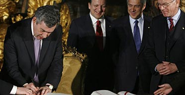 Gordon Brown signs the EU's Lisbon Treaty.