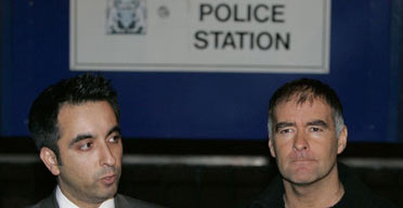 Tommy Sheridan (right) makes a statement outside Gayfield police station in Edinburgh with his lawyer, Amar Anwar