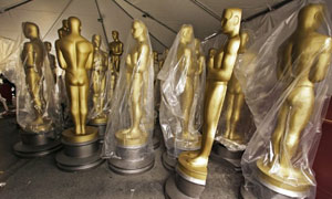 Oscars statues wrapped in plastic used in the production of Sunday's 79th Academy Awards. Photograph: Damian Dovganes/AP