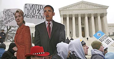 Anti-abortion activists hold up depictions of Democratic presidential candidates Hillary Clinton and Barack Obama outside the supreme court in Washington.