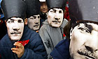 School children wearing paper Ataturk masks