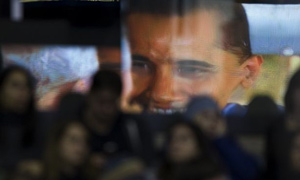 An image of Barack Obama is reflected in glass before a campaign rally in Madison, Wisconsin. Photograph: Morry G