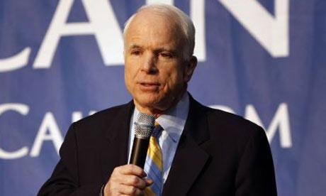 John McCain speaks at a town hall meeting in Indianapolis. Photograph: Gerald Herbert/AP