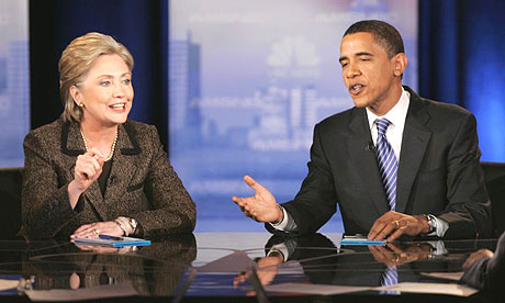 Hillary Clinton and Barack Obama respond to a question during their  Democratic presidential debate in Cleveland, Ohio
