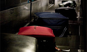 Suitcases on a luggage belt