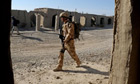 Prince Harry on patrol through the deserted town of Garmisir