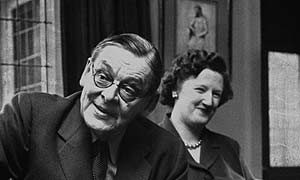 Nobel prize winning poet TS Eliot (1888 - 1965) has a drink with his second wife Valerie