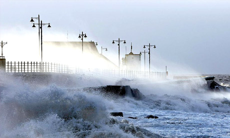 Waves lash the seafront at Porthcawl, Wales