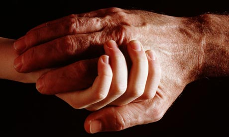 Elderly man and boy hold hands. Photograph: Henry Wolf/ Getty Images