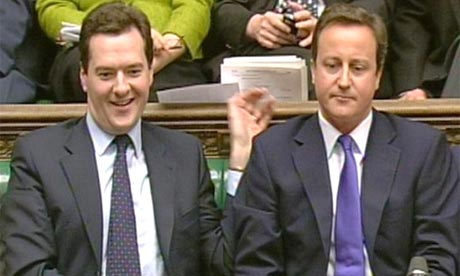 Tory shadow chancellor George Osborne and leader David Cameron react to the chancellor's budget speech in the House of Commons