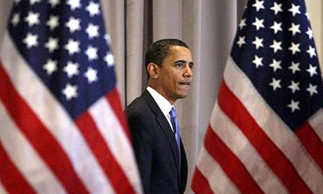 Democratic presidential hopeful Barack Obama walks between two American flags at a news conference in Chicago