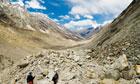 Trekkers crossing Gangotri glacier in Indian Haimalayas