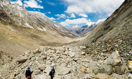 Trekkers crossing Gangotri glacier in Indian Haimalayas