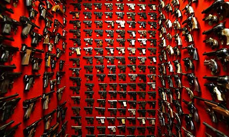 Guns line the walls of the firearms reference collection at the Washington Metropolitan police department headquarters in Washington