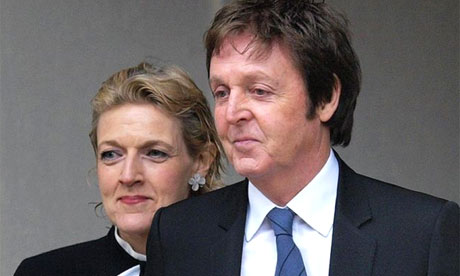 Paul McCartney leaves court with his wet-haired lawyer, Fiona Shackleton