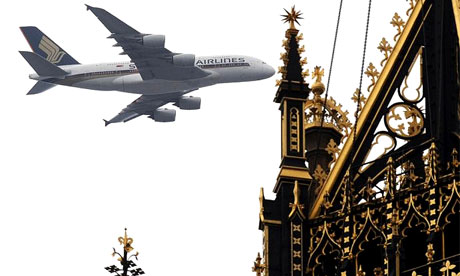 The Singapore Airlines superjumbo flies over the Palace of Westminster in London today as it approaches Heathrow airport for the first time