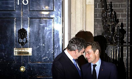 Gordon Brown greets Nicolas Sarkozy.