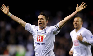 Robbie Keane celebrates scoring against Chelsea