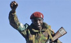 An arriving soldier reacts to cheering civilians on Anjouan island in the Comoros