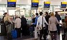 Passengers queue in Terminal 5, Heathrow.