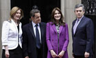 Gordon Brown and his wife Sarah welcome Nicolas Sarkozy and his wife Carla Bruni-Sarkozy outside 10 Downing Street