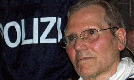 Sicilian Mafia boss Bernardo Provenzano arrives at a police station in Palermo